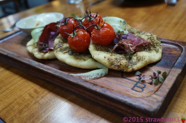 Breakfast mezze, za'atar flatbread, tomato, cucumber, mint, labne and air dried beef ($18)